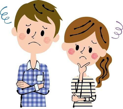 夫婦で困った表情